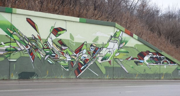 geometric shapes, dynamic shapes, mural on three toned green background on a railway underpass, painted by a group led by IAH Digital (Mediah) on Eglinton Ave