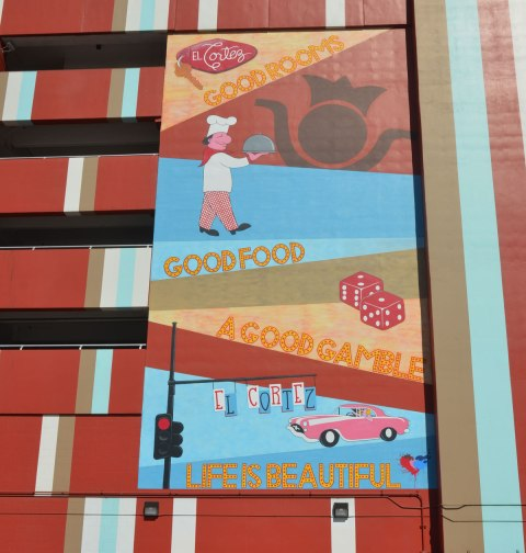 mural on the side of the el cortez hotel in las vegas that looks like it might be an advertisement. Good Food, A good gamble, Life is Beautiful