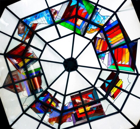 glass mosaic ceiling that is almost circular, octagonal but the sides are not equal width.