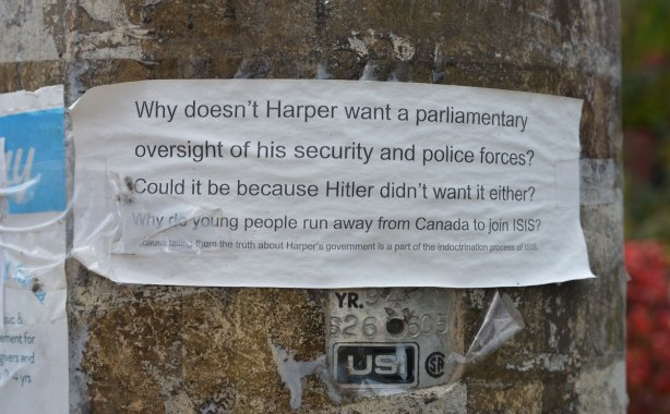 small paper taped to a hydro pole on a residential street. On the paper are typed the words: WHy doesn't Harper want a parliamentary oversight of his security and police forces? Could it be because Hitler didn't want it either? Why do young people run away from Canada to join ISIS?