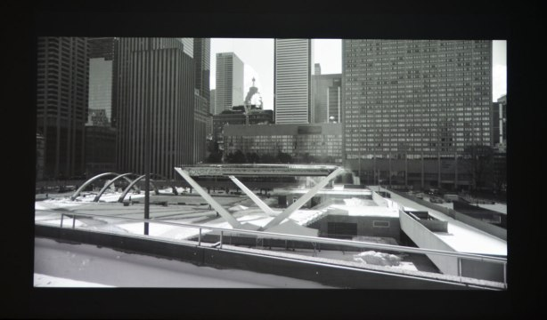 One of the images shown in an art installation on a large wall screen, a black and white picture overlooking Nathan Phillips Square in the winter.