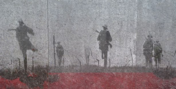 An etching of men running across a battlefield with rifles at the ready.