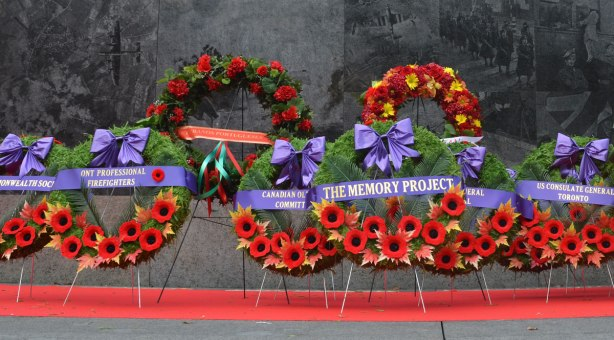 wreaths in front of the granite wall of the Ontario Veterans Memorial