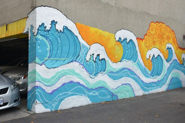 wave mural by Monica on the Moon in a laneway, the mural is styled after Katsushika Hokusai