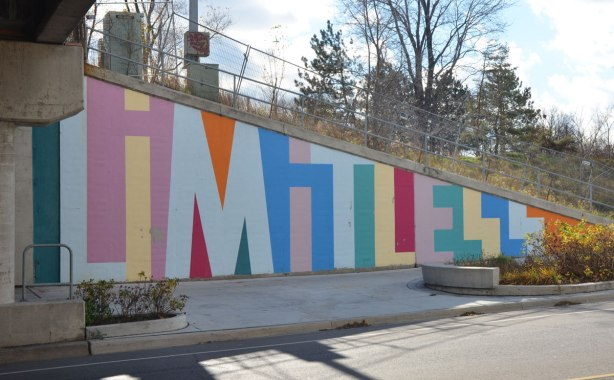 part of a mural on an underpass. There are four parts to the mural and each part is word painted in large capital letters in many colours - the word limitless