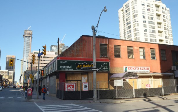 A block of two storey stores on Yonge street has been boarded up in preparation for demolition.