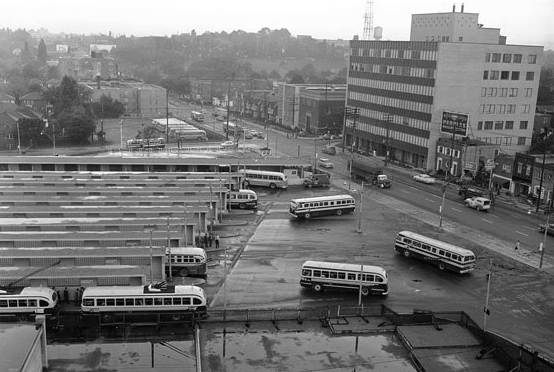 historical black and white photo, aerial, from Yonge Street looking west along Eglinton Ave showing the bus bays at Eglinton subway station, up to Duplex Ave is shown clearly.