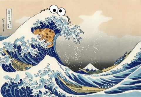 picture of Great Wave off by K Hir, with Cookie Monster eyes photoshopped onto the largest wave, a cookie added under the crest of the wave to make it looki like cookie monster (from Sesame Street) is eating the cookie.