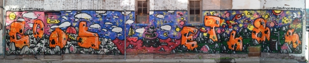 a long horizontal street art painting