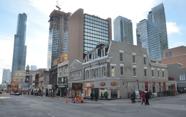 sw corner of yonge and breadalbane streets showing older stores in the foreground and taller condos in the background.