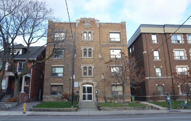 Two four storey apartment complexes and a single family home on Vaughan Road.