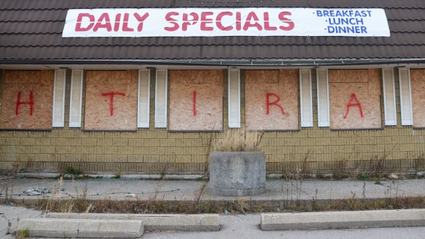 daily specials banner on the roof of an abandoned restaurant near Hamilton