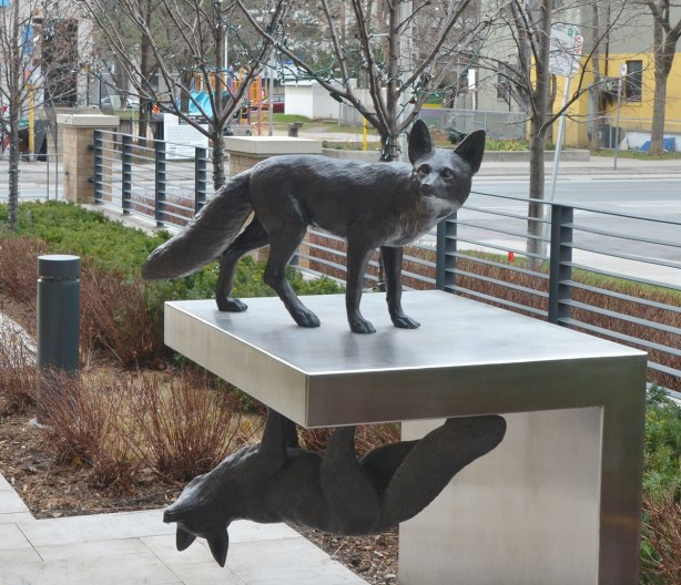 part of an art installation by Eldon Garnet called inversion - two foxes, one on top of the other on a metal platform. The bottom one is upside down
