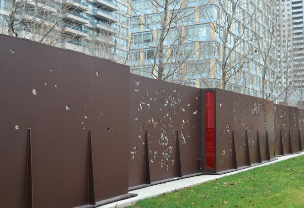 a steel wall between a park and a residence