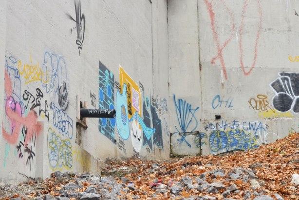 graffiti in the corner of a bridge support, concrete,