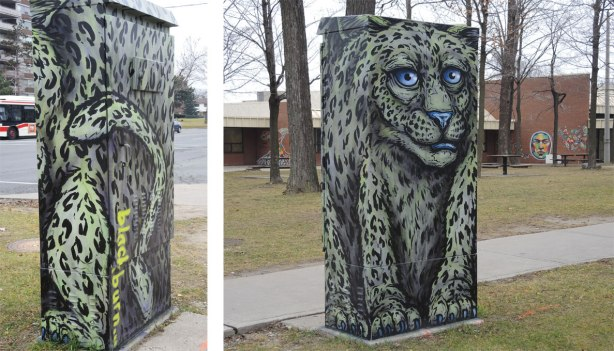 A metal box on a street corner, a leopard by street artist blackburn