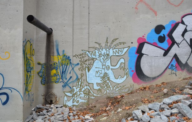 graffiti under a bridge, light blue character