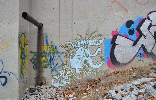 graffiti under a bridge, light blue character