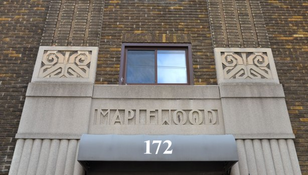 stonework over the door of the Maplewood apartments at 172 Vaughan road, and the art deco like decorations beside it.