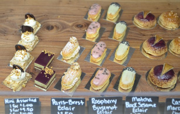 miniature eclairs for sale in a store