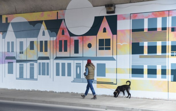 part of a mural by Rob Matejka and Tommy Matejka on the wall on a TTC subway underpass at Keele, a mural of houses on a street