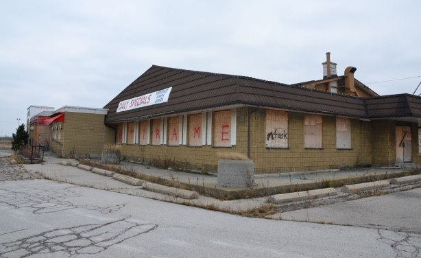 abandoned restaurant stop 50 with boarded windows. Still has a sign that says daily specials