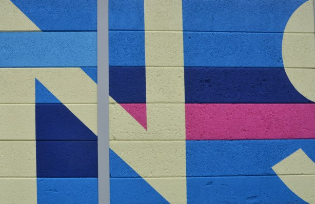 close up of the letter N and part of S in the Transitions mural on a TTC fence on Coxwell ave.