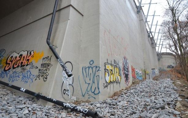 graffiti on concrete bridge supports