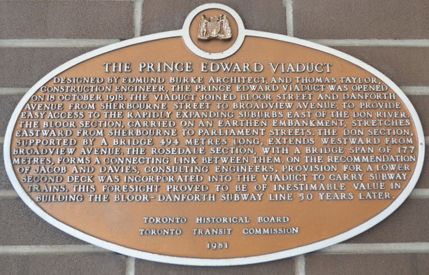 Toronto Historical commission sign about the history of the Prince Edward Viaduct, a bronze plaque posted on the brick wall, interior, of Castle Frank subway station.