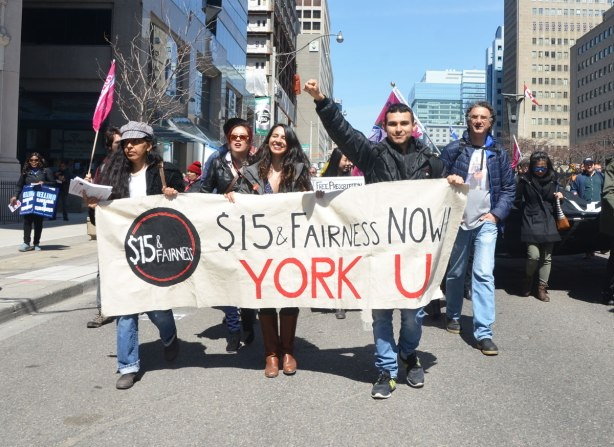 photographs taken at a rally and protest in support of a $15 minimum wage, The Fight for 15 and fairness - the contingent from York University, behind a banner that says $15 fairness now.