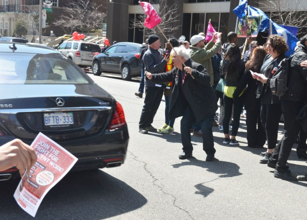 photographs taken at a rally and protest in support of a $15 minimum wage, The Fight for 15 and fairness - a car passes by the rally and as it does, people try to persuade the driver to honk his horn.