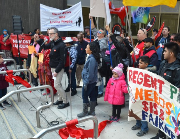 photographs taken at a rally and protest in support of a $15 minimum wage, The Fight for 15 and fairness - speakers and a few people holding signs at the top of the stairs, using that part as a stage