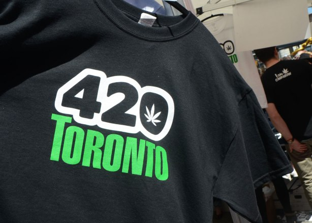 Part of 420 day celebrations at Dundas Square - a black Tshirt for sale. It has 420 Toronto on it, with a cannabis leaf in the middle of the zero