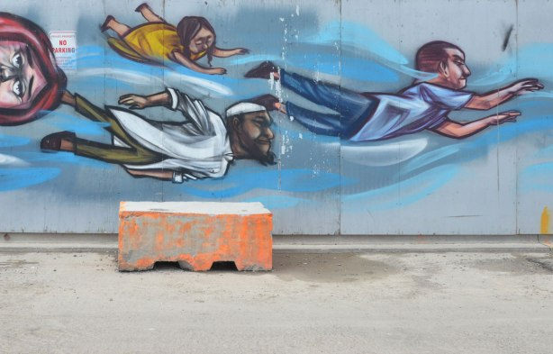 flying people mural by elicser