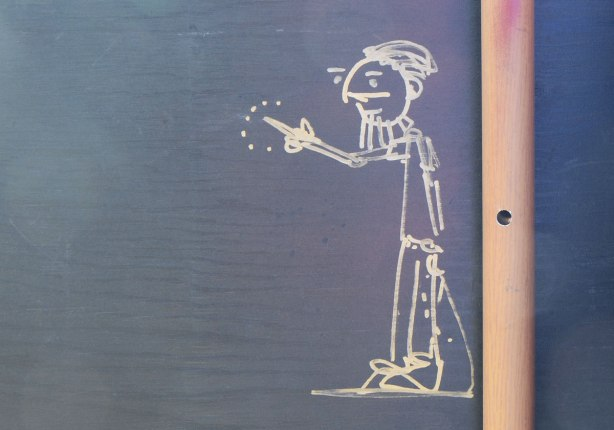 graffiti, white stick drawing of a man with a beard pointing his finger, or giving someone the finger, hard to tell