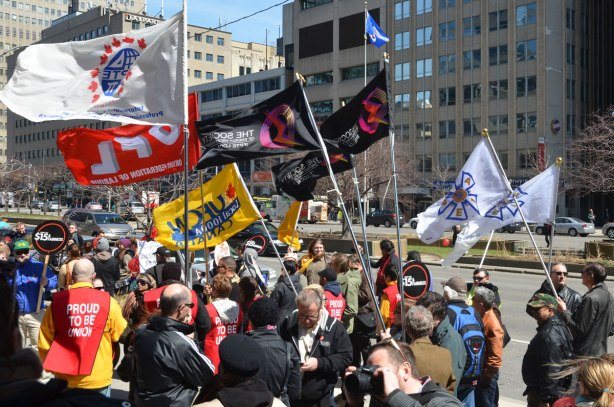 photographs taken at a rally and protest in support of a $15 minimum wage, The Fight for 15 and fairness - people, many different union flags