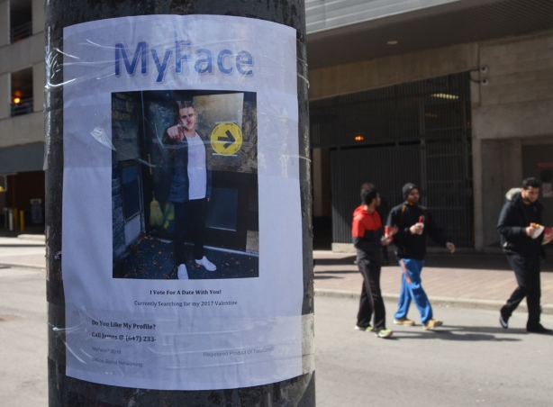 "a poster taped to a pole on a street with the heading ""MyFace"", a picture of a young man pointing at the camera. Words on the bottom say:"