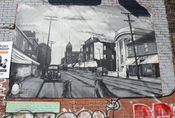Black and white mural of historical picture of Queen St East