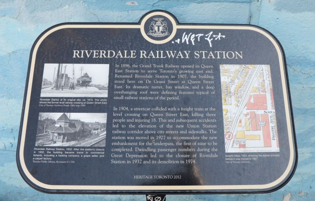 historical plaque describing the history of Riverdale train station at Queen St. East and De Grassi St in Toronto