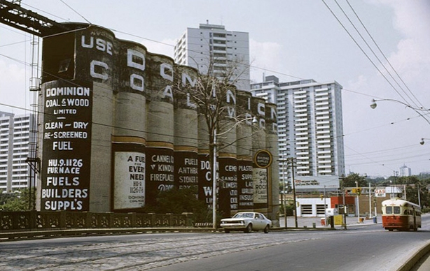 picture of the Dominion Coal and Wood silos on Mt. Pleasant, from city of Toronto Archives, taken about 1972. With an old Mt. Pleasant streetcar on the street by the silos.