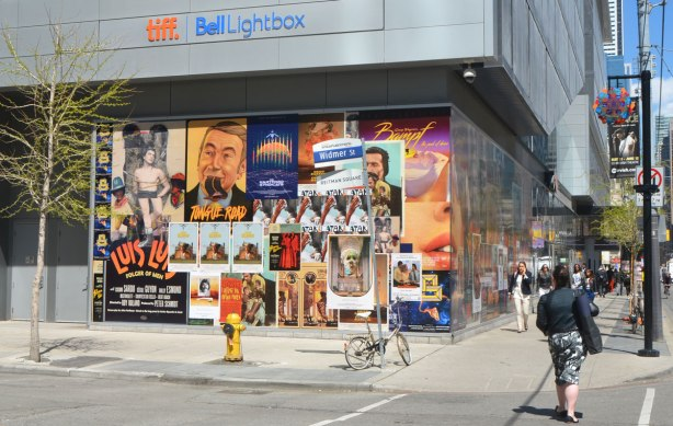 at the corner of King and another street, the TIFF Bell Lightbox building has an art installation on two sides, walls of fake movie posters. The installation is called 'Coming Attractions' and it is by a collective of artists known as The Long Weekend.