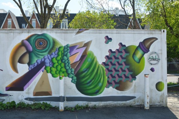 street art mural on a garage door in an alley by birdo - a creature with a green and purple body and head that looks like a parrot