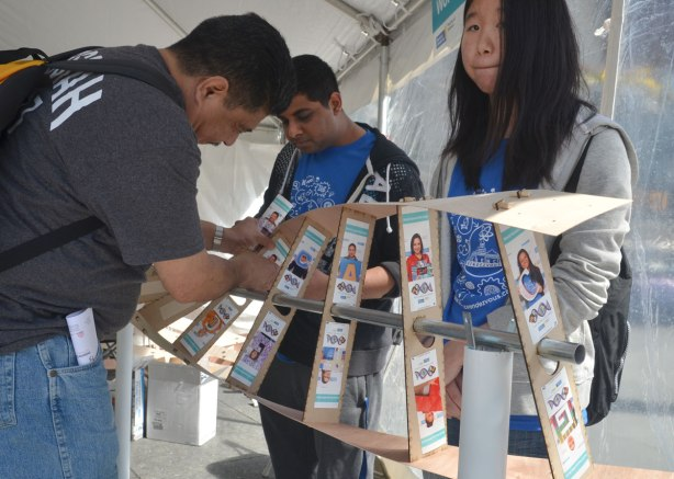 People making a DNA model using photos that volunteers have had taken of themselves with one of the letter of DNA. The four letters are A, C, T, and G. They are the nucleosides that make up DNA