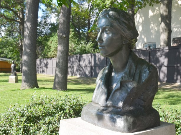 bust of Frances Loring, a Canadian sculptor, in a park, in the shade of a large tree