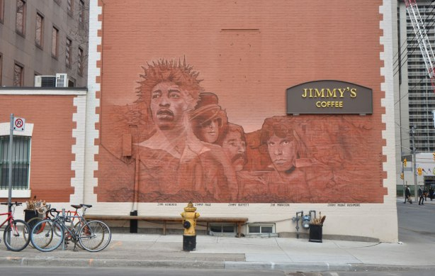 mural on the side of Jimmys coffee, monochromatic in rust, pictures of what Mount Jimmy Rushmore would like, four famous Jimmys, Jimi Hendrix, Jimmy Page, Jimmy Buffett and Jim Morrison