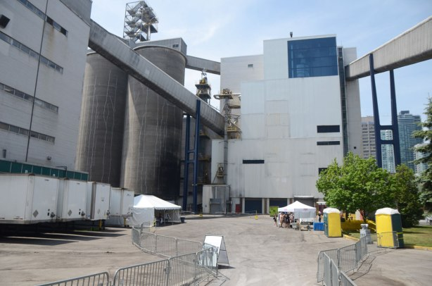 sugar processing area of Redpath Sugar refinery, some white tents and metal barricades for crowd control as it is Doors Open day.