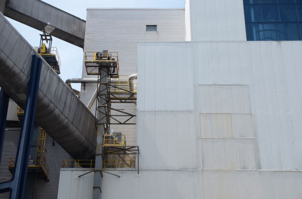 close up of the white Redpath Sugar processing plant, grey metal covers on conveyor belt tunnels and vents