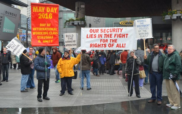 May day, International Workers Day rally at Dundas Square on a rainy day -
