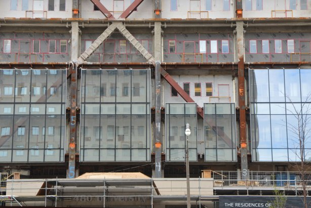 lower part of building have its facade upgraded to glass panels