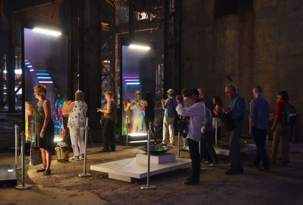 people interacting with an anaglyphic mirror at the 10th luminato festival, hearn generating station